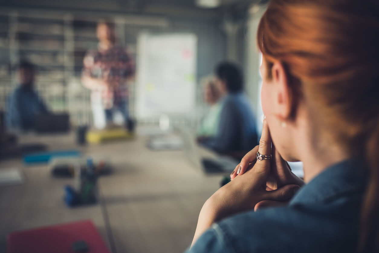 woman thinking intensely at a meeting