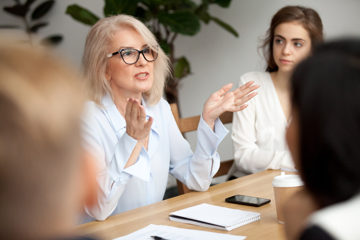 people talking at a meeting